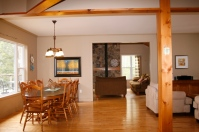 Open concept dining livingroom kitchen Elegant waterfront home Drag Lake Haliburton Dave Rattle Bancroft Real Estate.com www.welcometobancroft.com