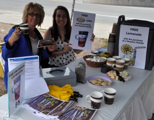 Hospice Coordinator Heather Brough and summer student Carly Smalczewski collect donations for the Hike for Hospice at the Bancroft Farmers' Market on August 22. For a $5 donation supporters received a free coffee, donated by Tim Hortons, a lavender shortbread and a reusable cup holder.